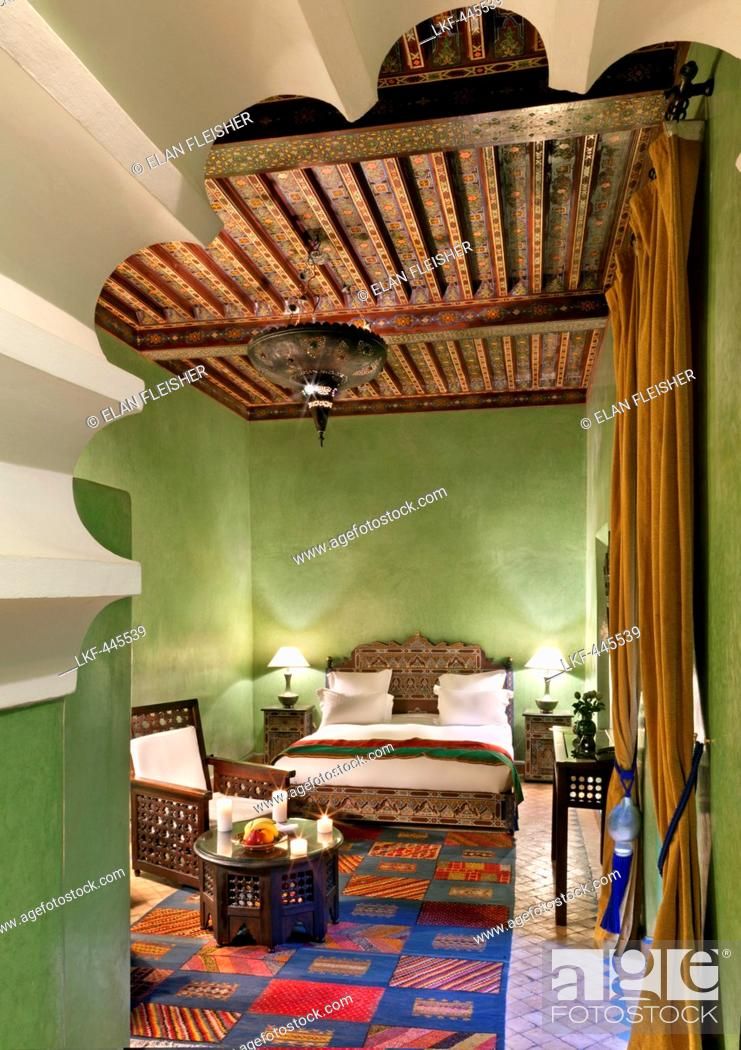 Stock Photo: Arched doorway leading into guest room, Dar Les Cigognes, Marrakech, Morocco.