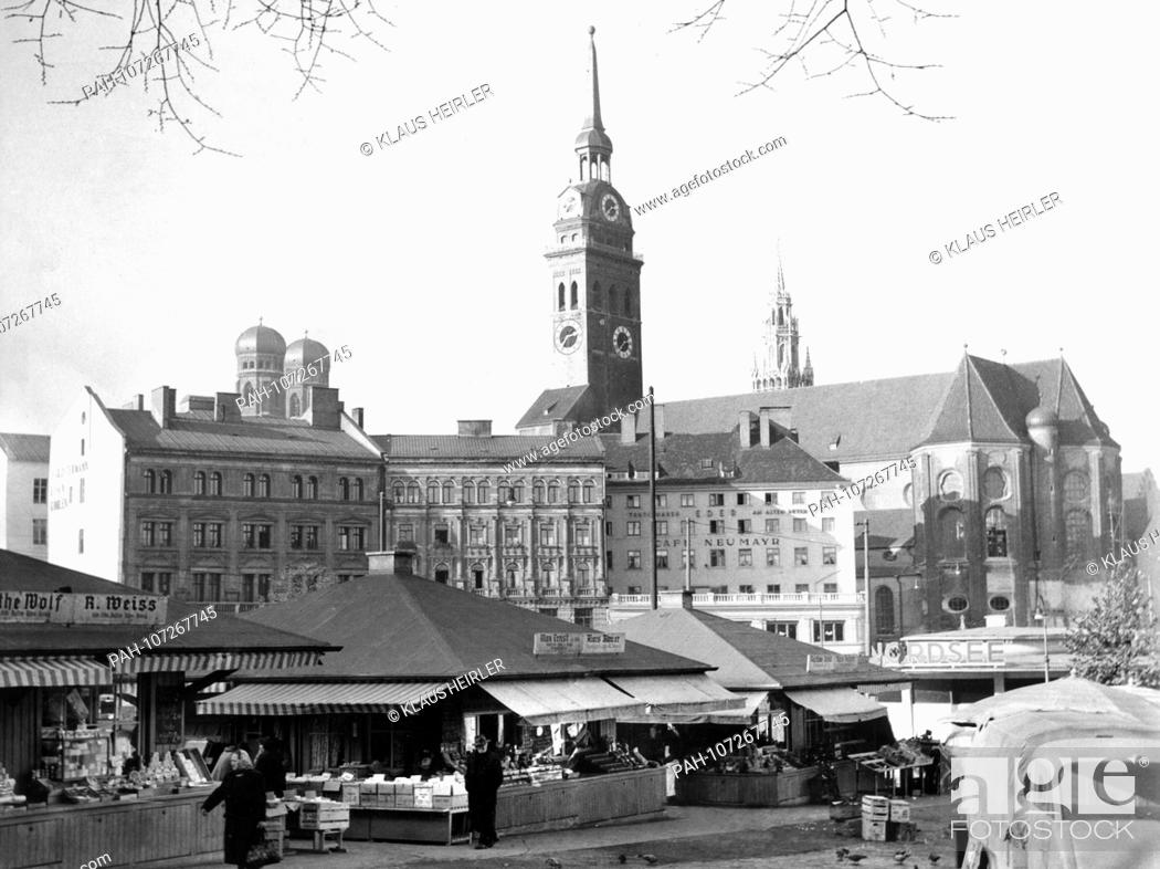 Stock Photo: The Viktualienmarkt in Munich in 1954 with the towers of the Frauenkirche in the background on the left, Old Peter in the middle and the tower of the New Town.
