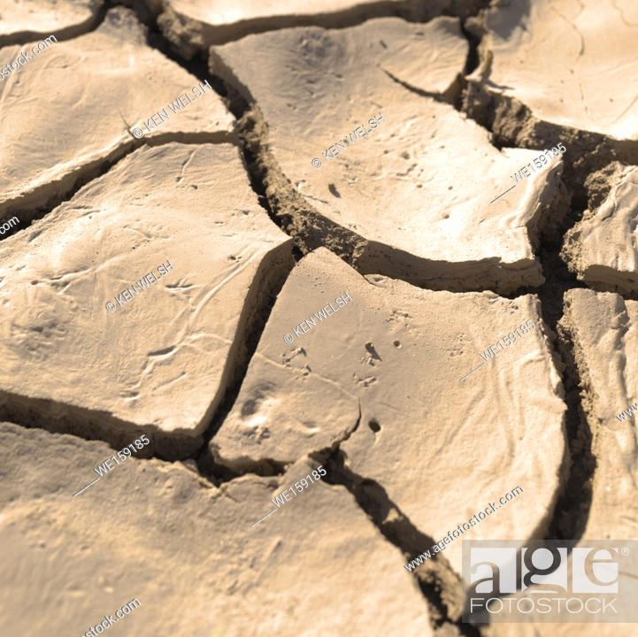 Stock Photo: Close up of cracked, dried earth creating an abstract pattern.
