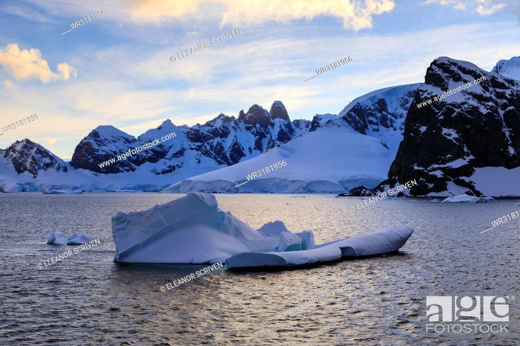 Stock Photo: Sunrise, atmospheric clouds, mountains, glaciers and icebergs, Danco Coast, Gerlache Strait, Antarctic Peninsula, Antarctica, Polar Regions.