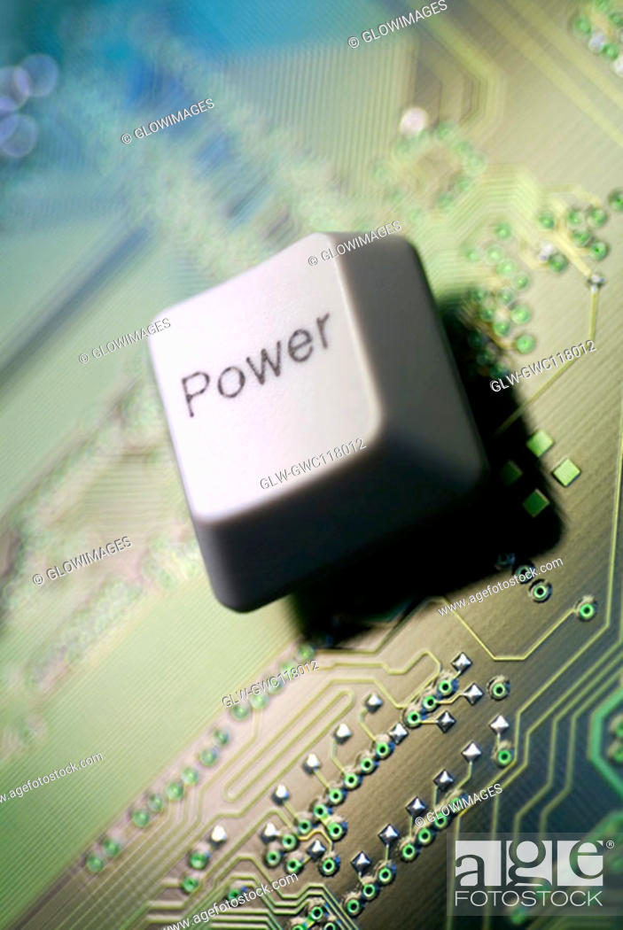 Stock Photo: Close-up of a computer key on a circuit board.