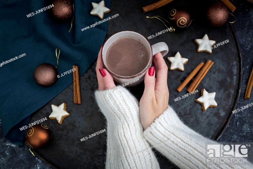 Stock Photo: Woman's hands holding cup of Hot Chocolate at Christmas time.