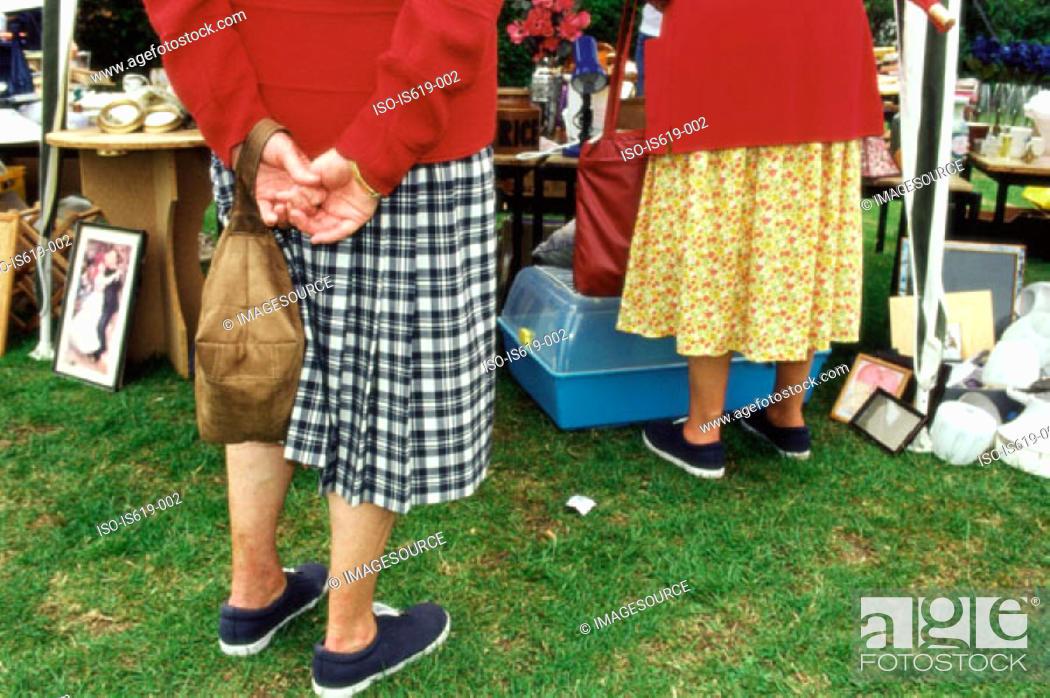 Stock Photo: Senior women at boot fair.