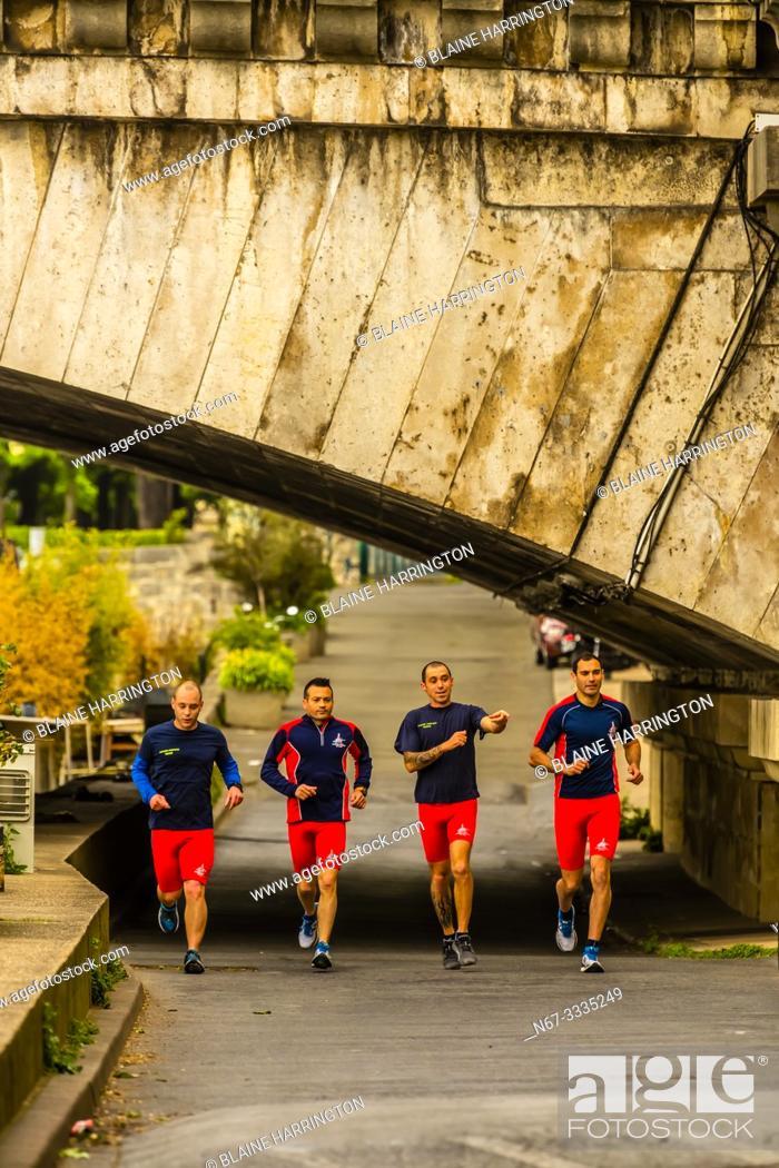 Photo de stock: Group of men jogging along the banks of the River Seine, near Pont de la Concorde, Paris, France.