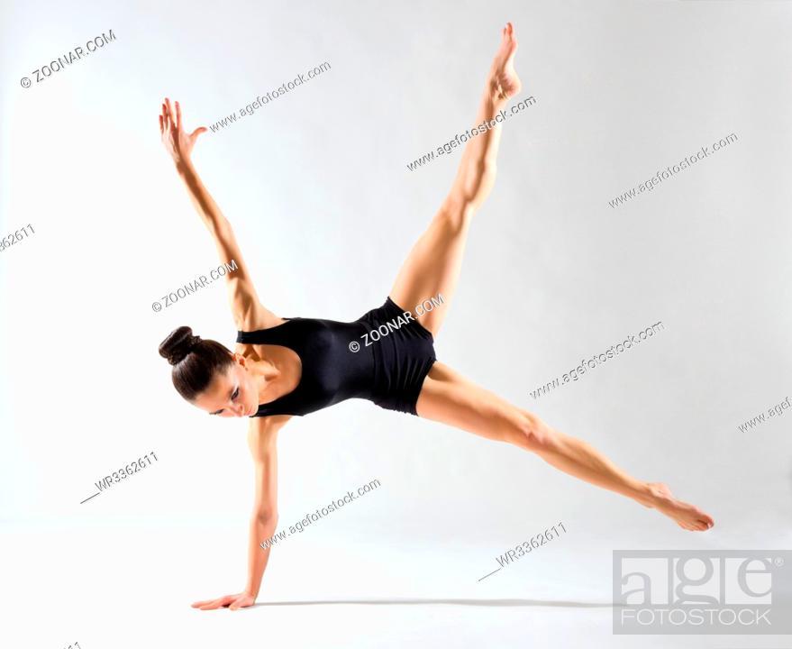 Stock Photo: Young ballerina (on grey version).