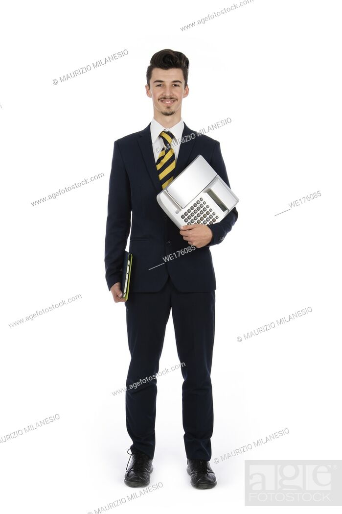 Stock Photo: Businessman standing in studio with computer and cash register under his arms, he is wearing a black suit, a striped tie and white shirt.