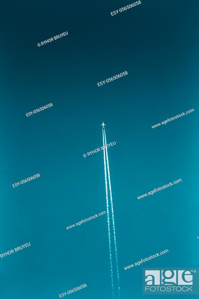 Stock Photo: Aircraft Plane Contrail In Blue Sky. Plane, aircraft, airplane flying up.