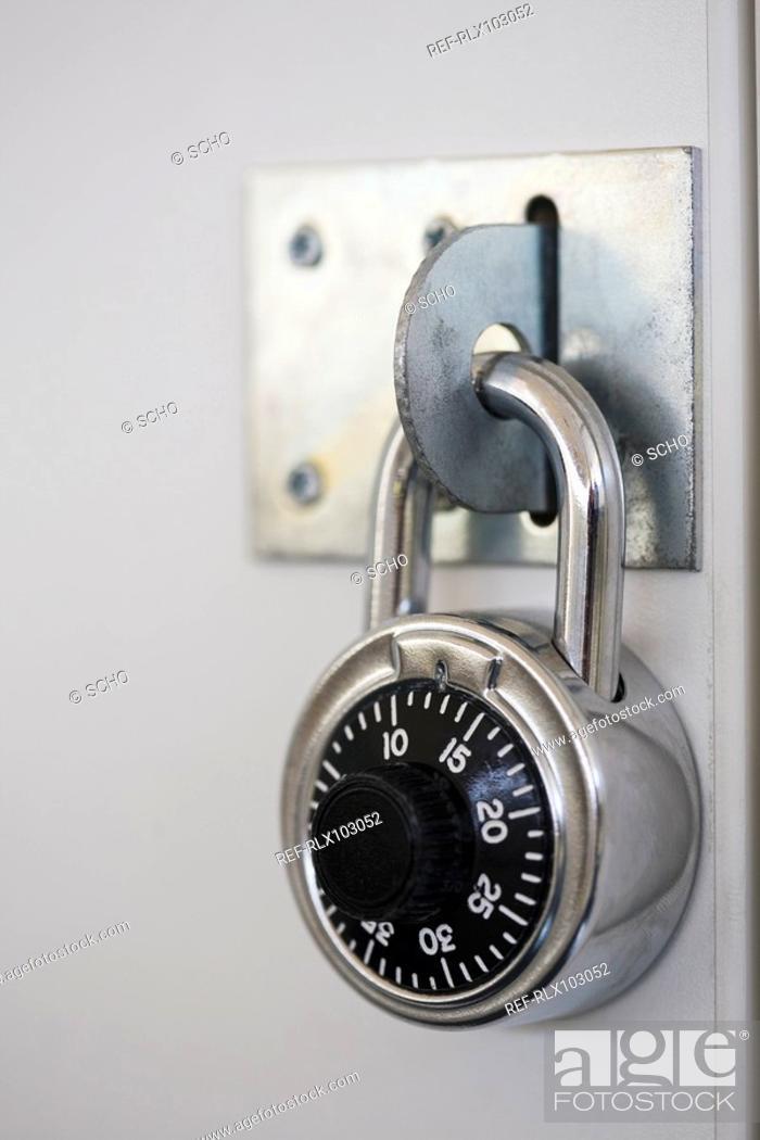 Stock Photo: Combination lock on school locker, close-up.