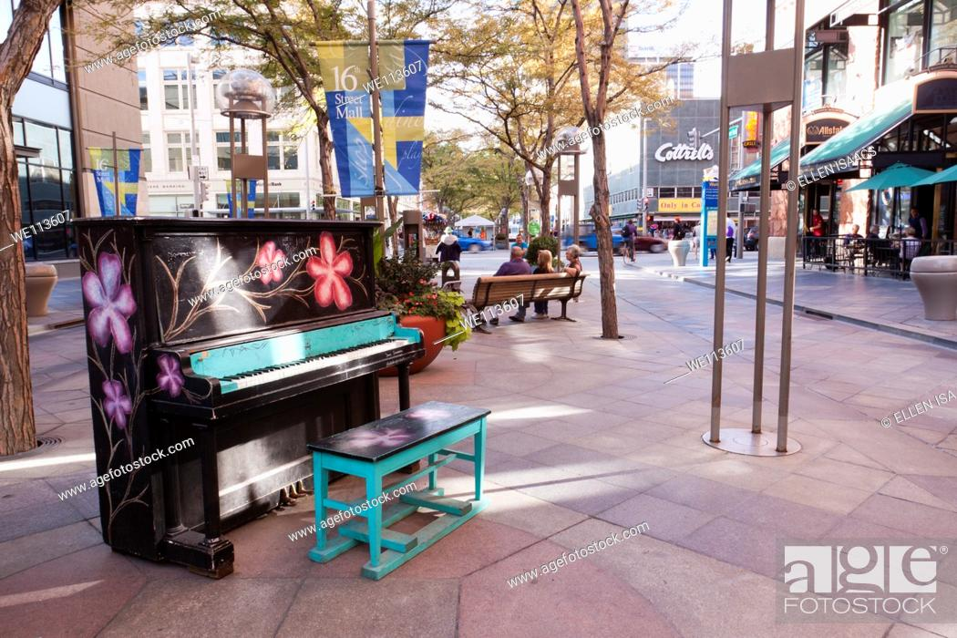 Stock Photo: Painted piano on 16th Street Mall in downtown Denver, Colorado, part of the Your Keys to the City public art program.