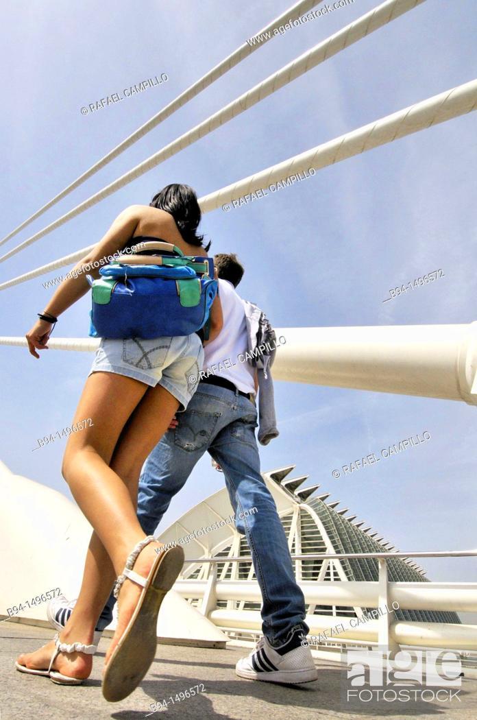 Stock Photo: Couple walking on l'Assut de l'Or bridge, City of Arts and Sciences by Santiago Calatrava, Valencia. Comunidad Valenciana, Spain.