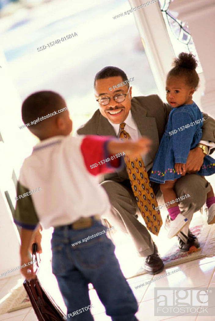 Stock Photo: Businessman meeting his son and daughter at the door.