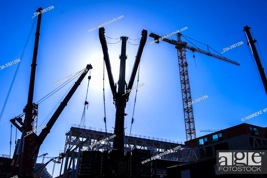 Stock Photo: Cranes at a construction site at Strijp-S, Eindhoven, The Netherlands, Europe.