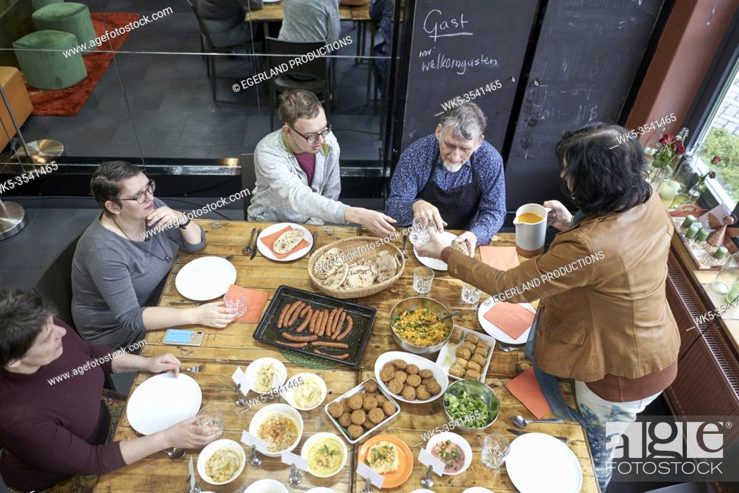 Stock Photo: group enjoying results of Middle eastern food cooking workshop.