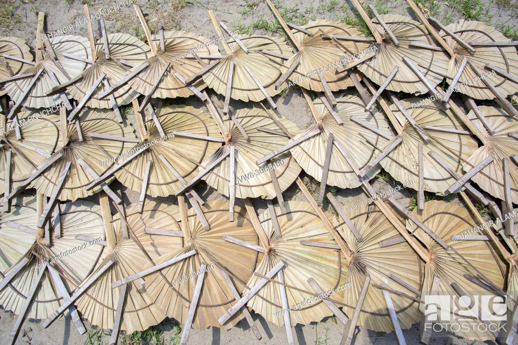 Stock Photo: 40 degree calices weather rural people need Hand held Fan. In Summer Bangladesh's weather become very hot above 40-45 degree calices.
