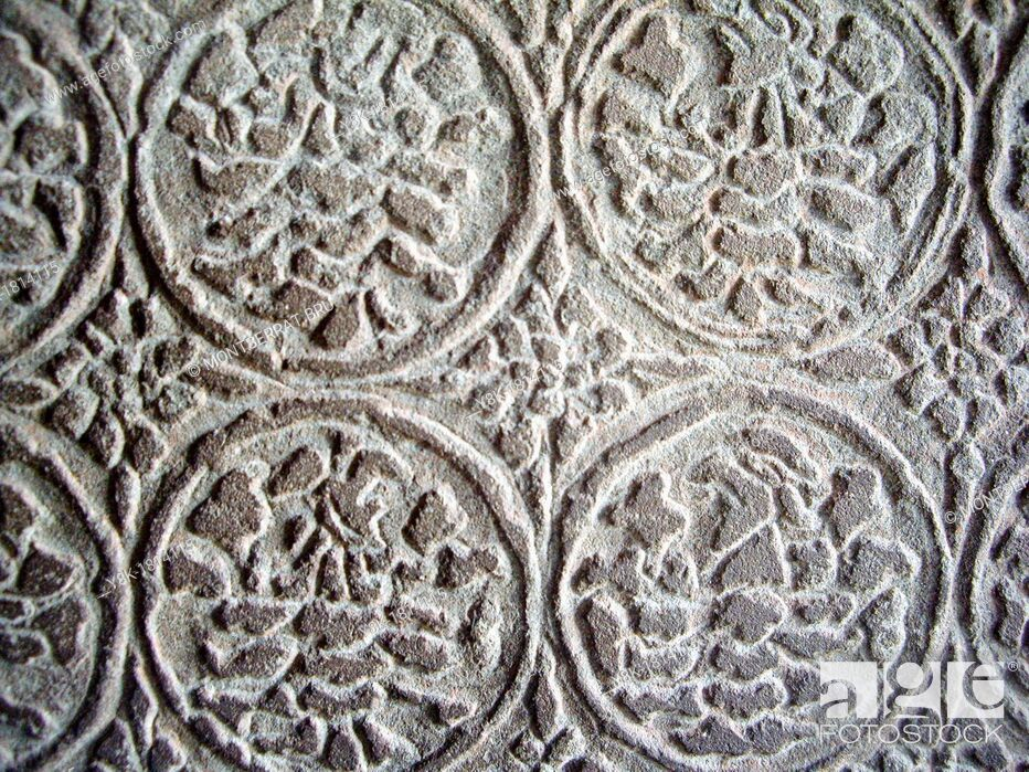 Stock Photo: Stone carving floral motive at Angkor Wat temple, Cambodia.