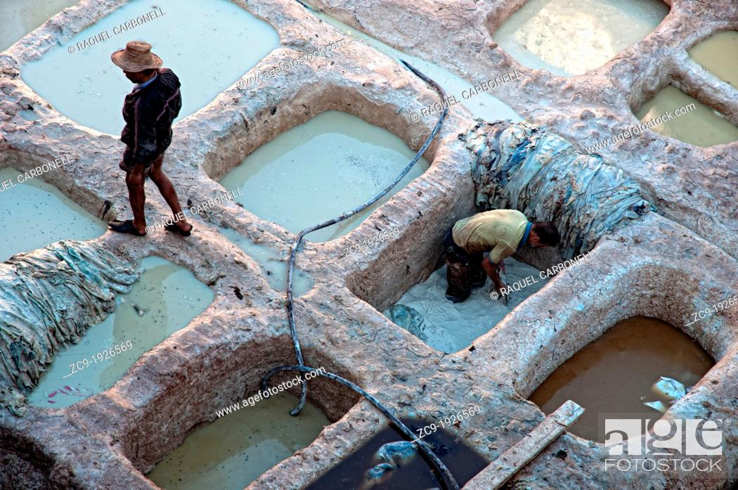 Stock Photo: Men working in a tannery in the medina of Fez  Fez el Bali, Imperial city, Morocco.