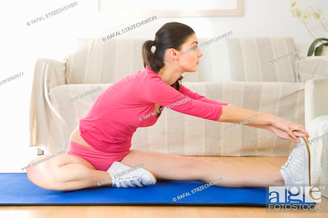 Stock Photo: young woman doing streaching exercising.