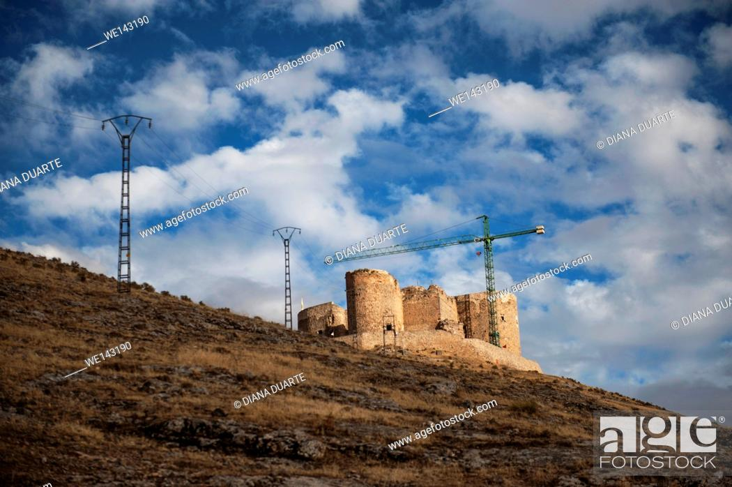 Stock Photo: The castle dates from the 10th century but is mostly ruins, it the view and the windmills that attract visitors. Consuegra, Toledo, Spain.