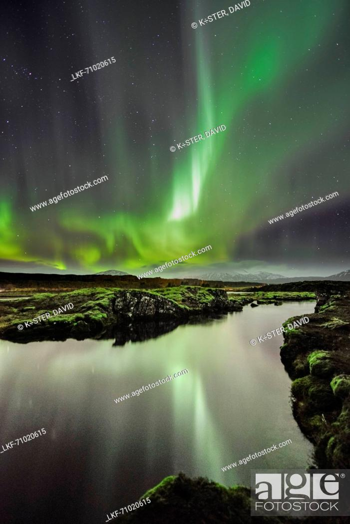 Stock Photo: Reflection of northern lights aurora borealis in Thingvallavatn lake, National Park Thingvellir, UNESCO world heritage, Golden Circle, Southern Iceland, Iceland.