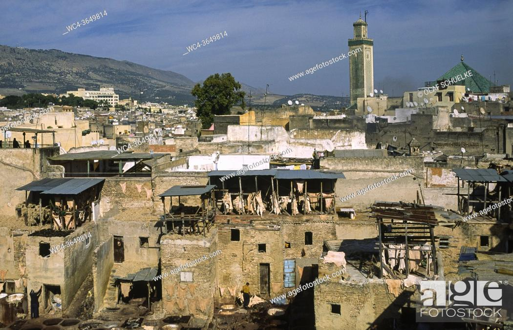 Stock Photo: Fes, Morocco, Africa - Elevated view over the roofs of a traditional tannery and dye factory in the walled medina with its historic buildings of the old city.