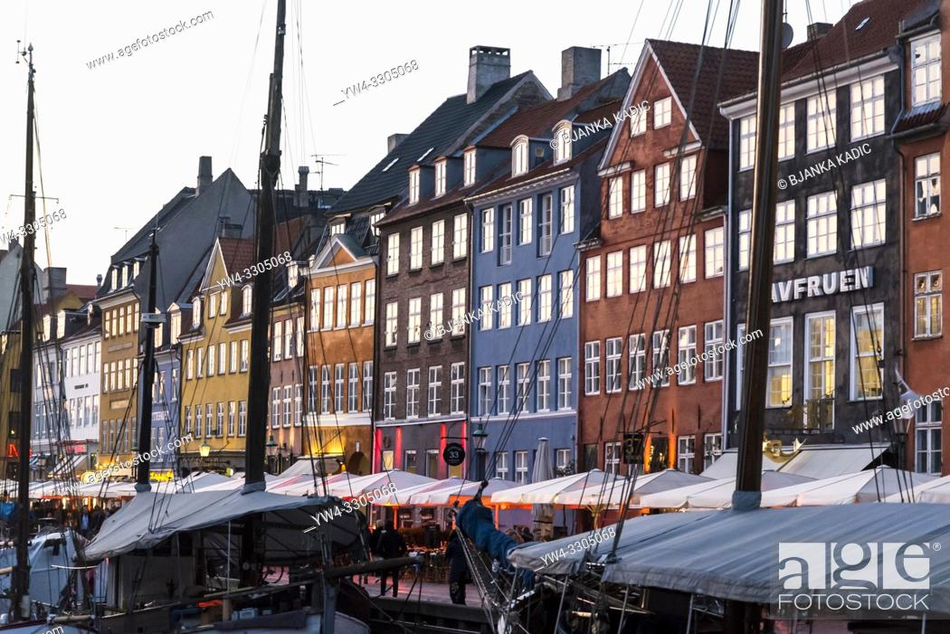 Stock Photo: Nyhavn or New harbour is a 17th-century waterfront, canal and entertainment district lined by brightly coloured townhouses and bars, cafes and restaurants.