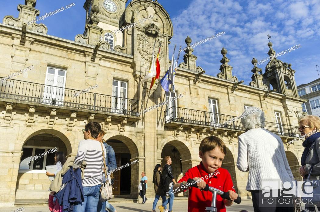 Stock Photo: People by the Baroque 18th c. Town Hall building at Praza Maior square in Lugo, Galicia, Spain, Europe.