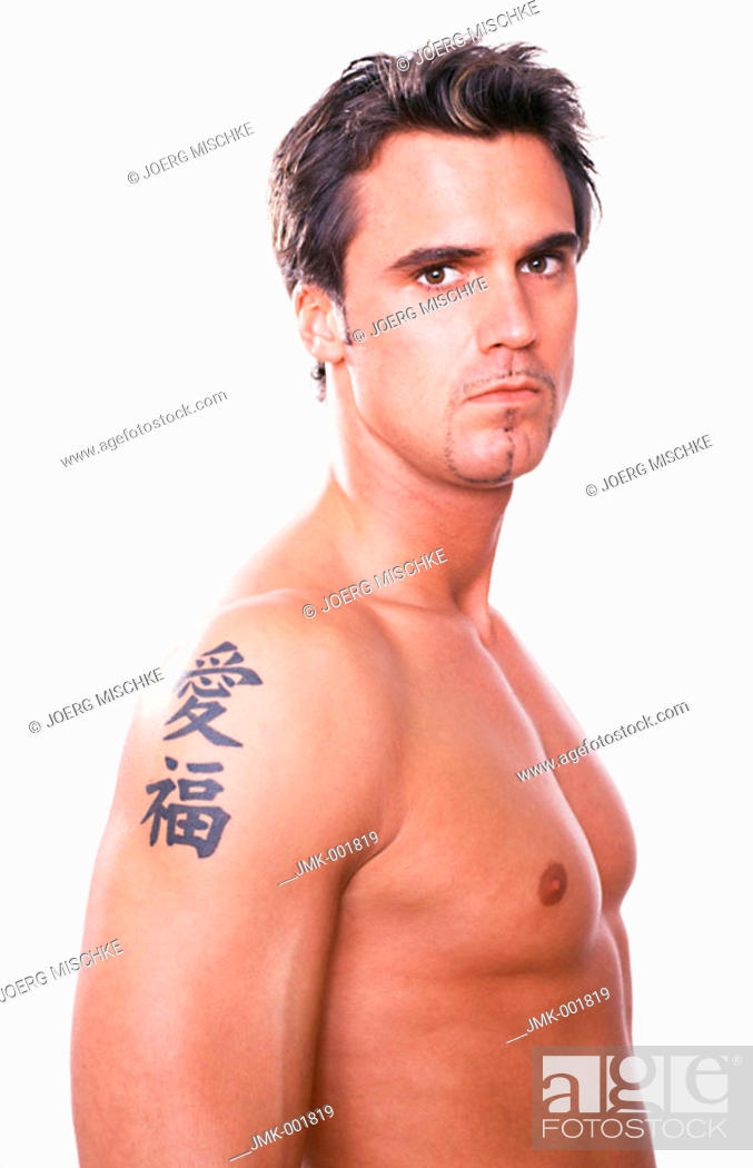 Stock Photo: The upper part of the body of a young man, 20-25 25-30 30-35 years old, masculine, athletic and beautiful, stripped to the waist.