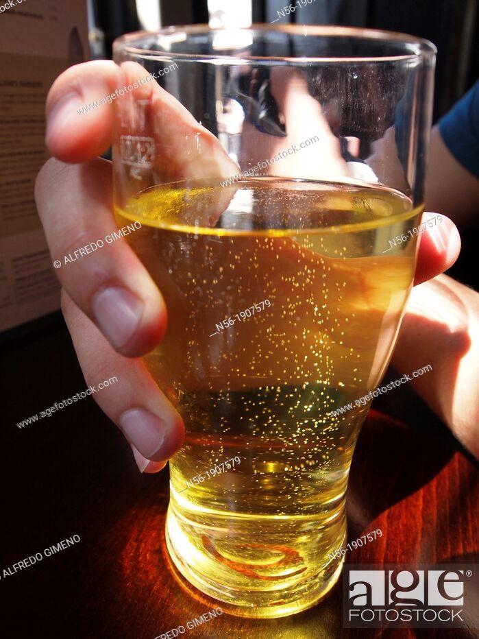 Stock Photo: Hand grabbing a pint, London.