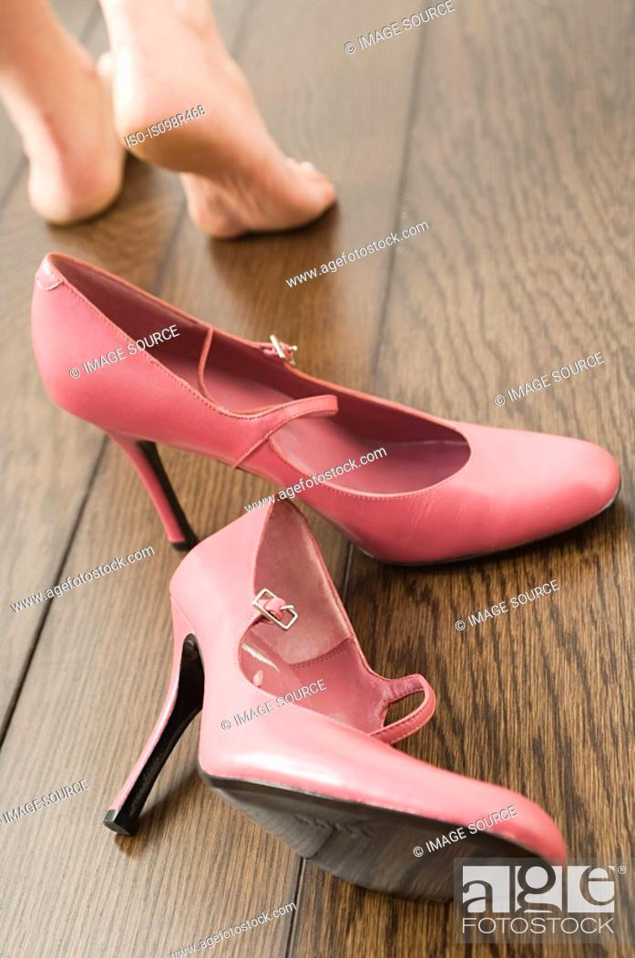Stock Photo: High heeled shoes and feet.