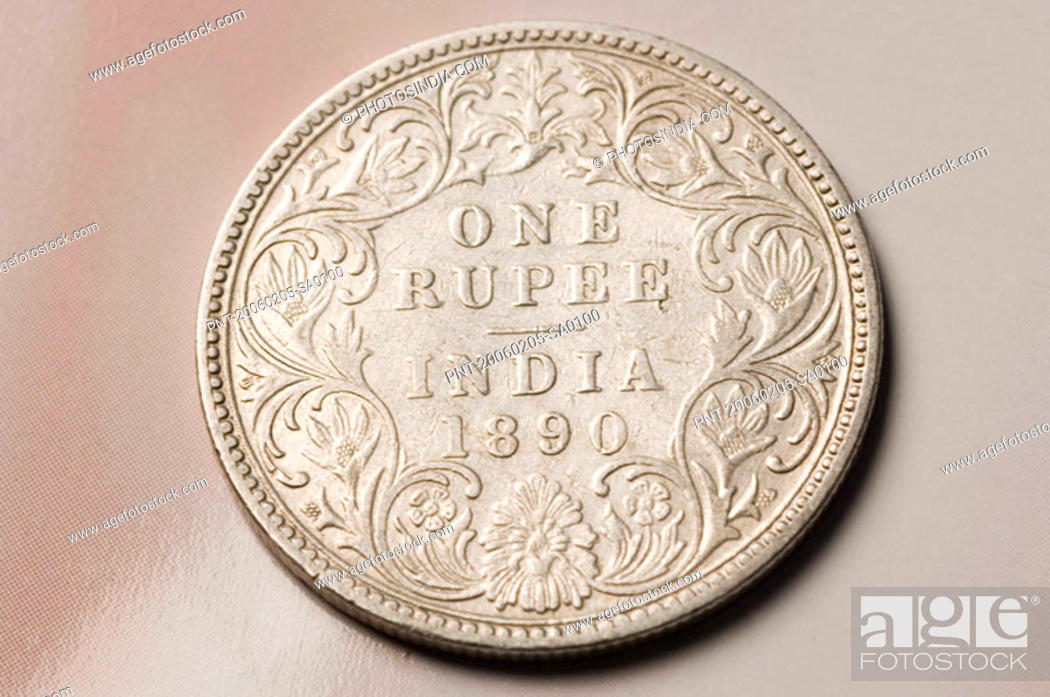 Stock Photo: Close-up of an antique Indian one rupee coin.