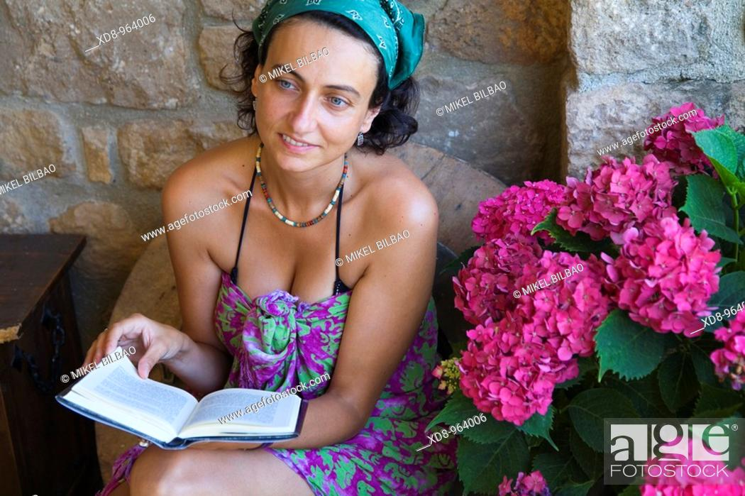 Stock Photo: young woman reading.