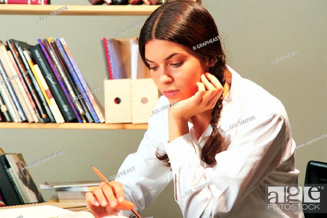 Stock Photo: A student studying at home.