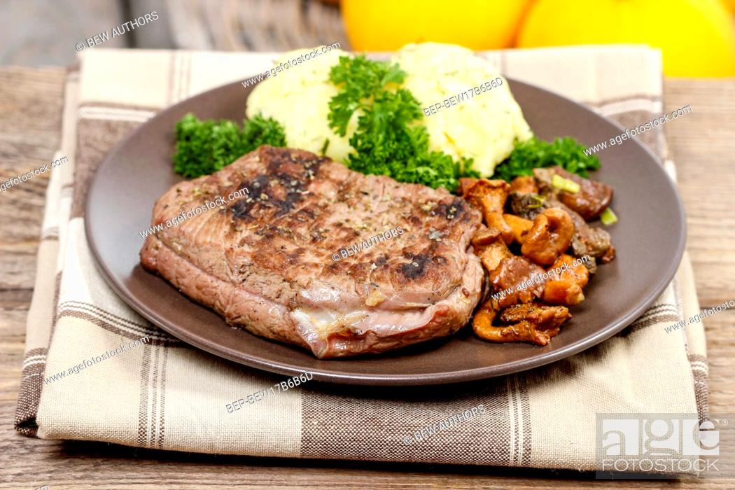 Stock Photo: Roasted beef with mushrooms.