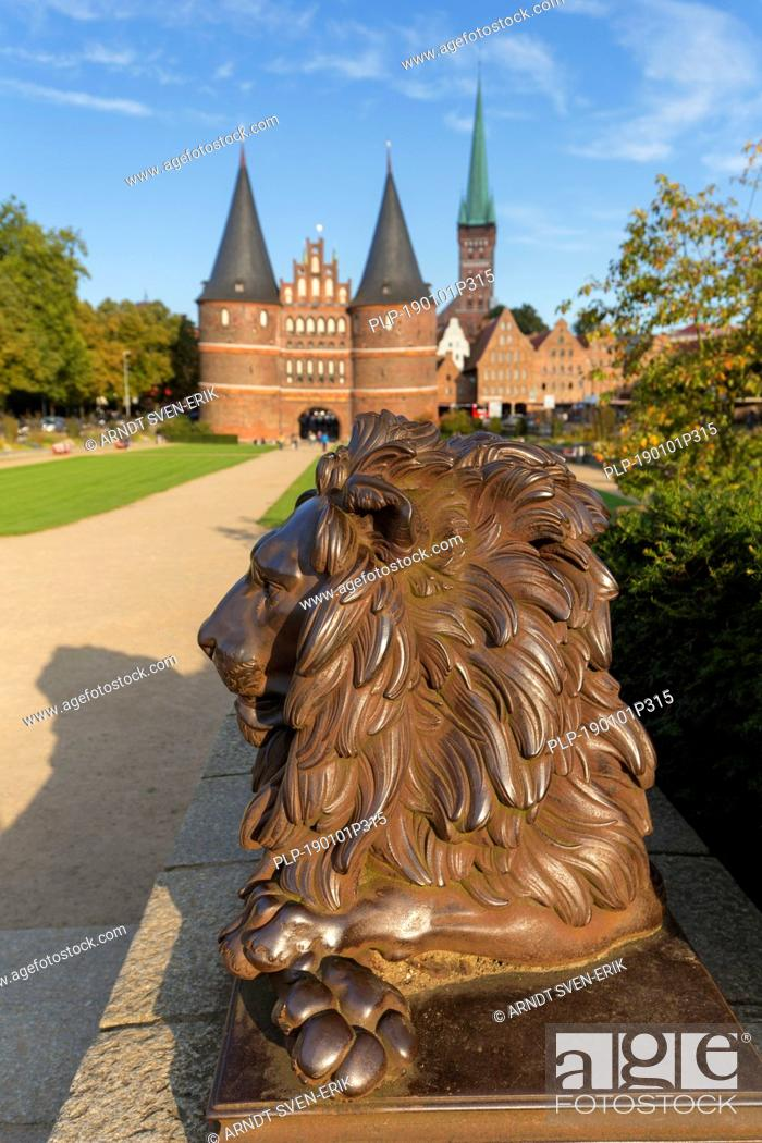 Stock Photo: Lion statue in front of the Holstentor/ Holstein Gate in the Hanseatic town Lübeck, Schleswig-Holstein, Germany.