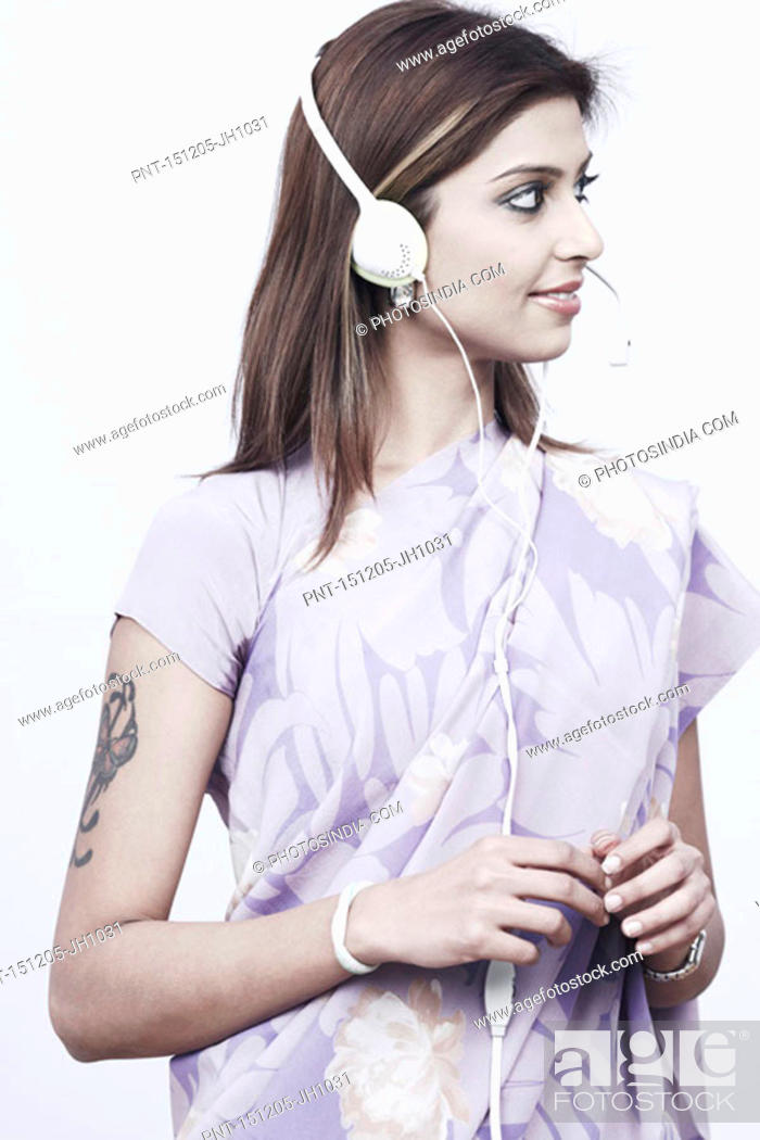 Stock Photo: Young woman wearing a headset.