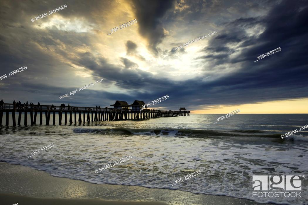 Stock Photo: Evening over the Naples Pier and Gulf of Mexico, Naples, Florida, USA.