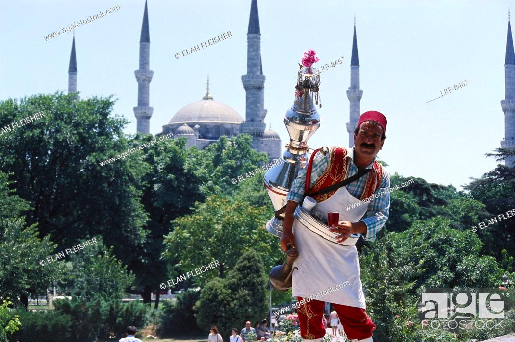 Stock Photo: Tea vendor in traditional clothes, Blue Mosque, Istanbul, Turkey.