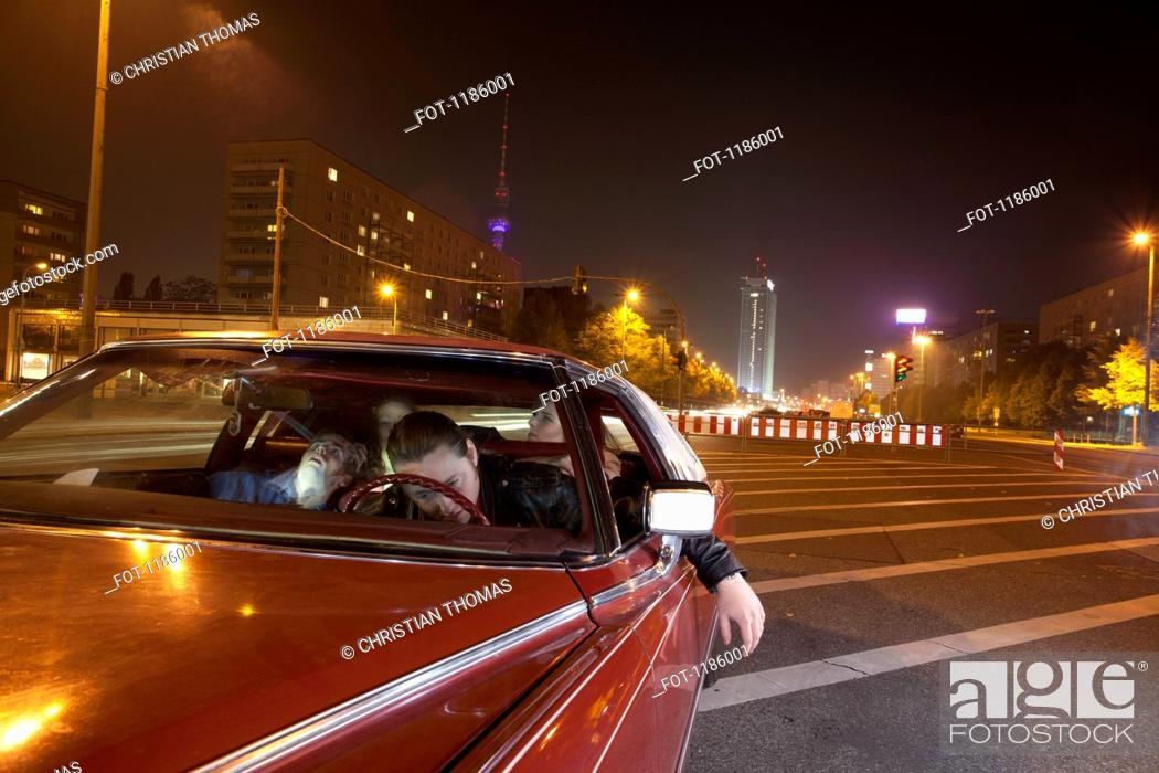 Stock Photo: Two male car crash victims in front seat with two distraught women in back seat.