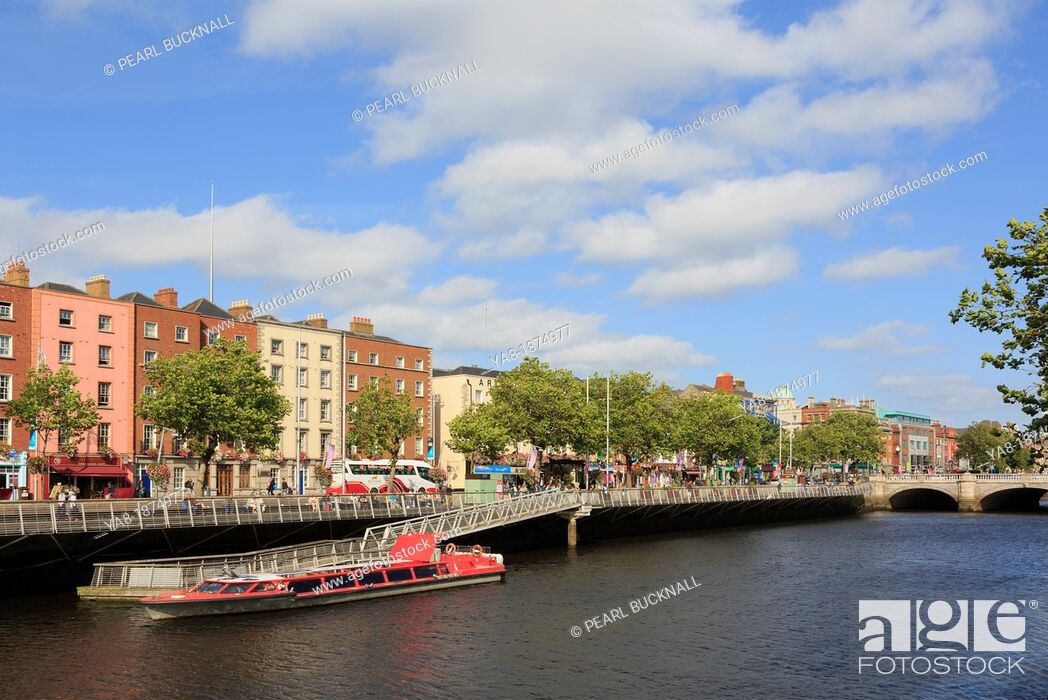 Stock Photo: Temple Bar, Dublin, Republic of Ireland, Eire, Europe  View across the River Liffey to Batchelor's Walk with cruise boat moored by jetty.