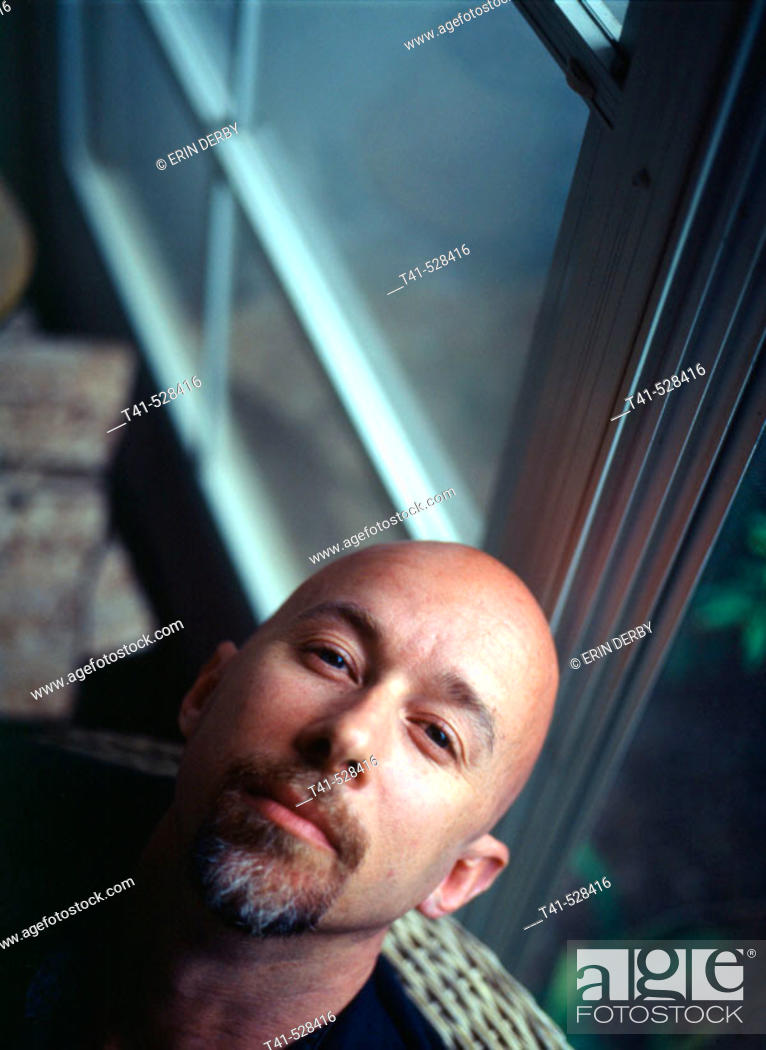 Stock Photo: A 40 year old man reclines at his parents' house in Pennsylvania, USA.