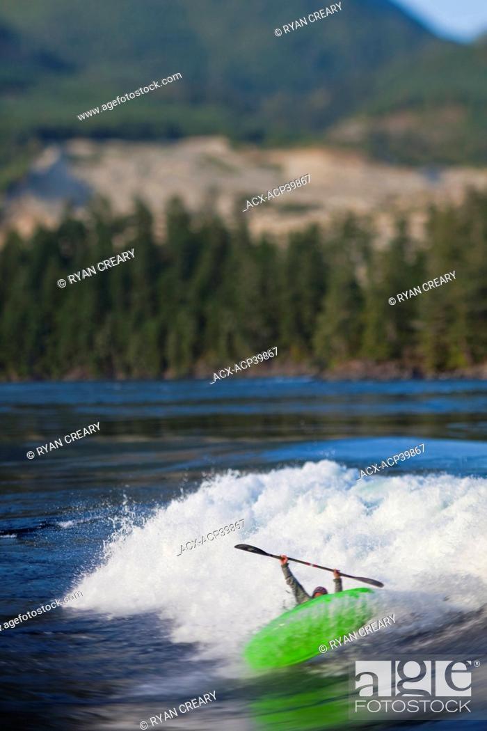 Stock Photo: Young man freestyle kayaking on Skookumchuk ocean rapids, Skookumchuck Narrows Provincial Park, Egmont, British Columbia, Canada.