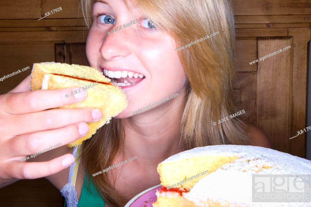 Stock Photo: Close up of girl eating victorian sponge cake.