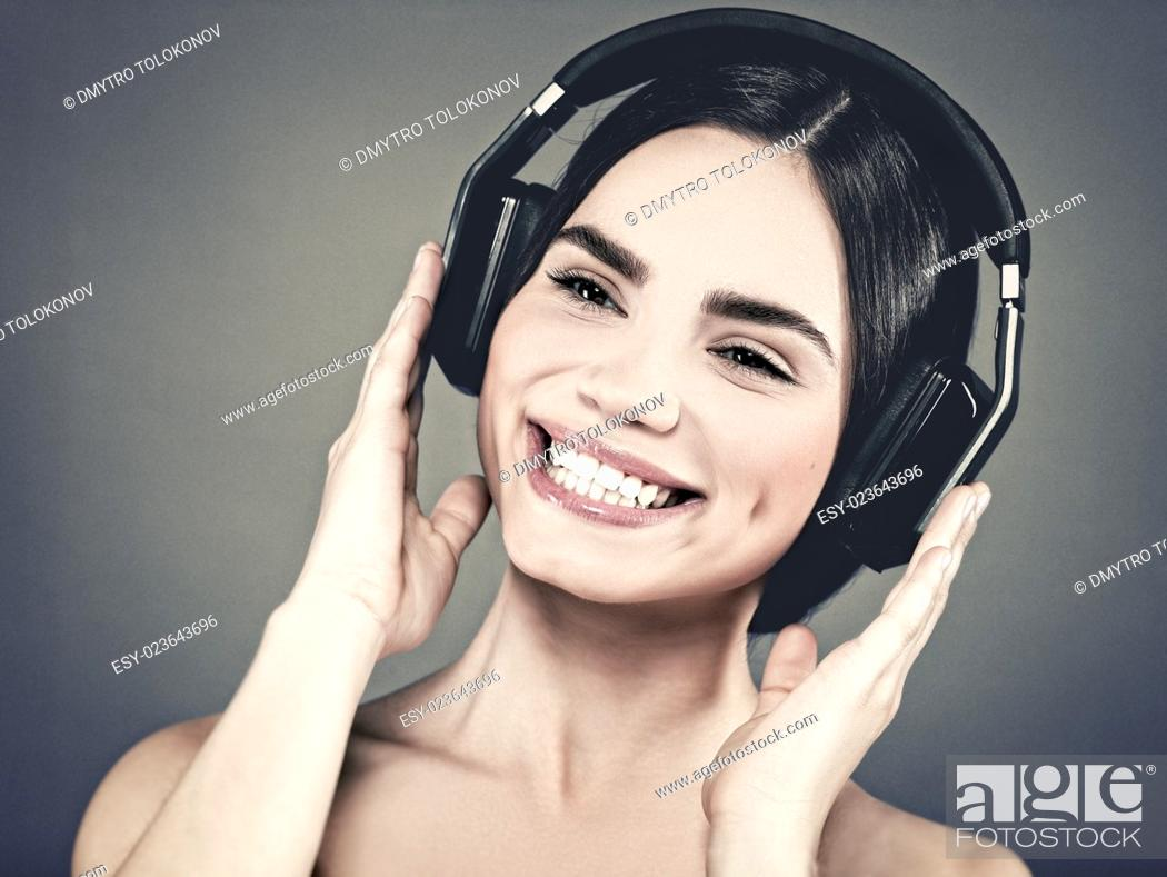Stock Photo: Hear the music, female portrait with headphones.