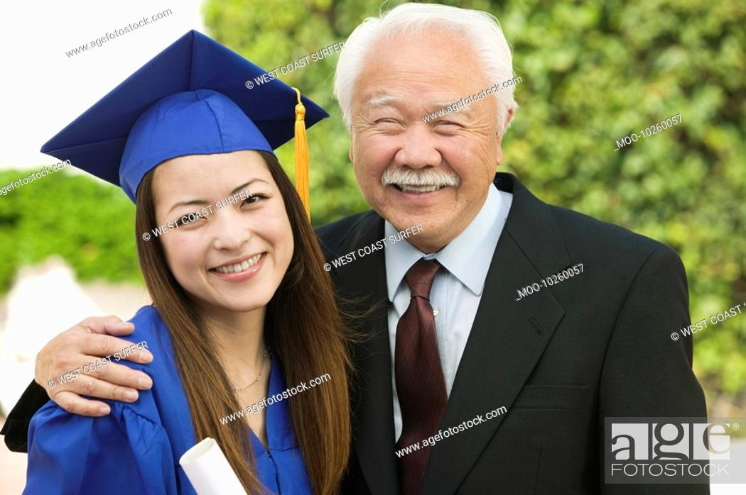 Stock Photo: Graduate and Grandfather outside portrait.