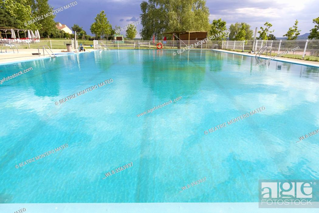 Stock Photo: Pools of a town in Burgos with cloudy sky in Salas de los Infantes, Spain.