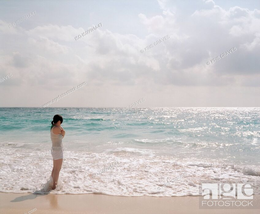 Stock Photo: Young woman looking out to sea, Bermuda.