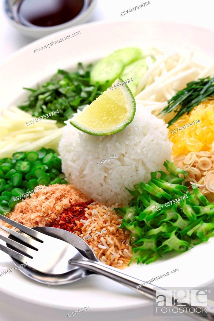 Stock Photo: khao yam, rice salad, thai cuisine.