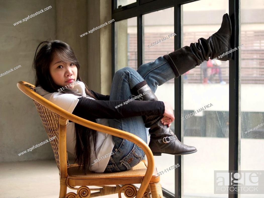 Stock Photo: Young asian woman posing.