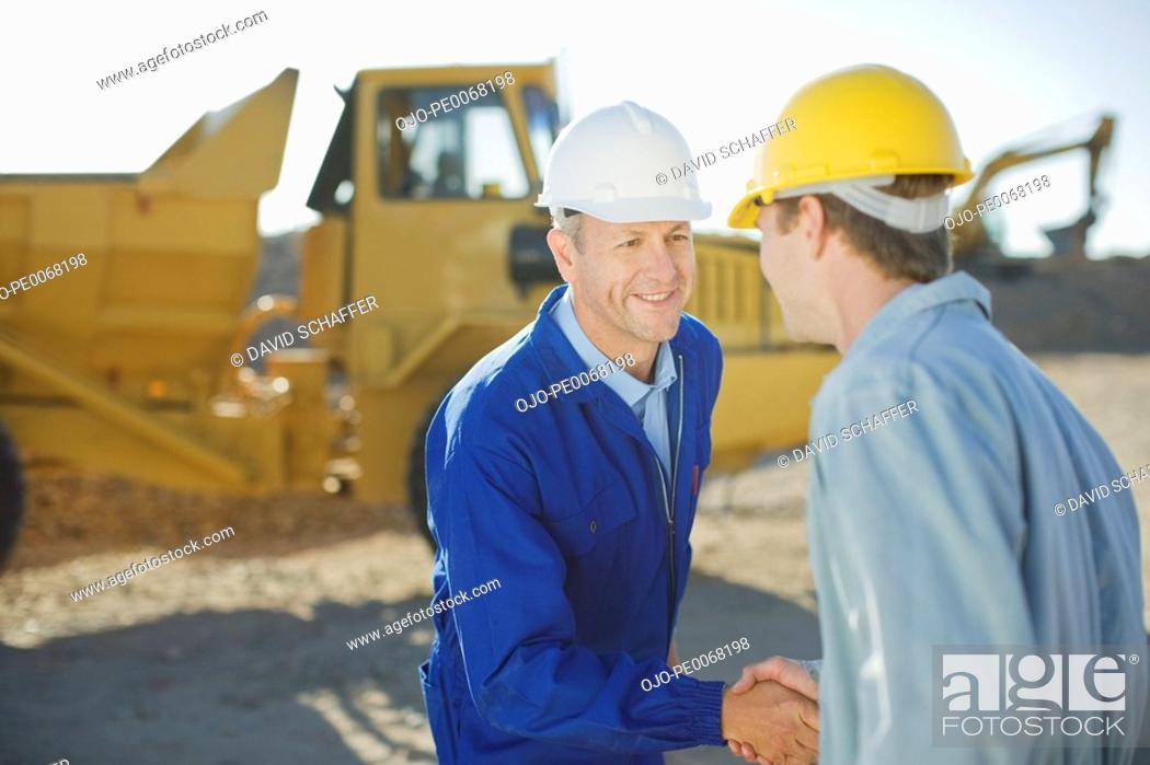 Stock Photo: Construction workers shaking hands.