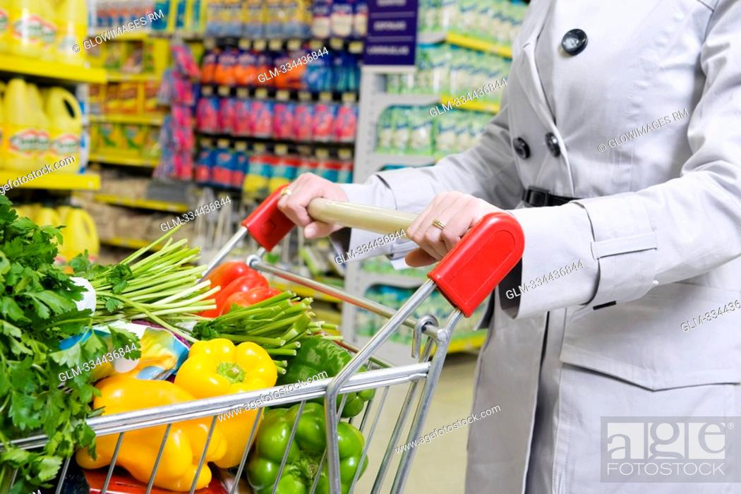 Stock Photo: Woman shopping vegetables in a supermarket.